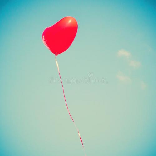 red-heart-shaped-balloon-flying-away-45976272.jpg